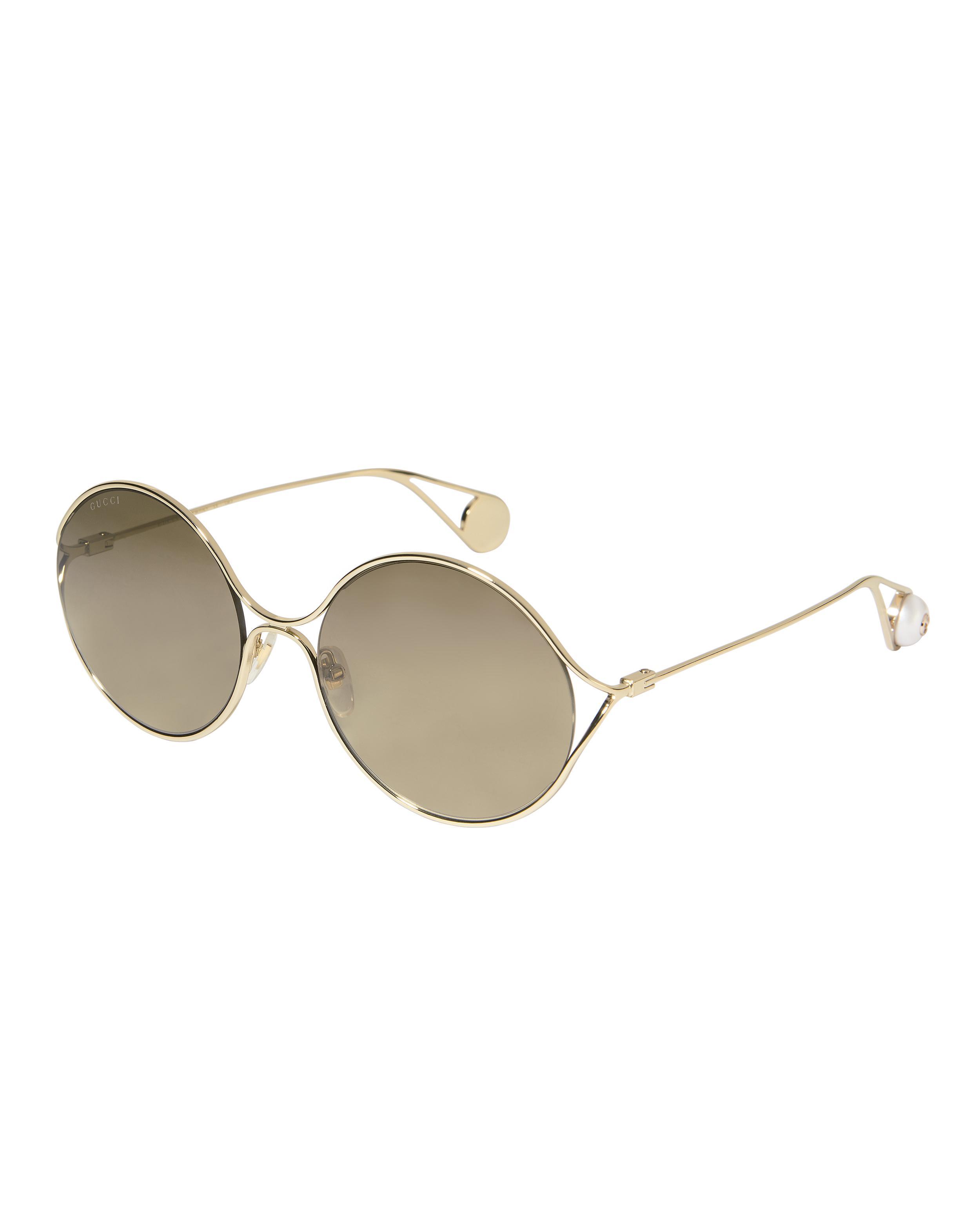 ffb7ce468b8 Lyst - Gucci Oval Metal Sunglasses in Metallic