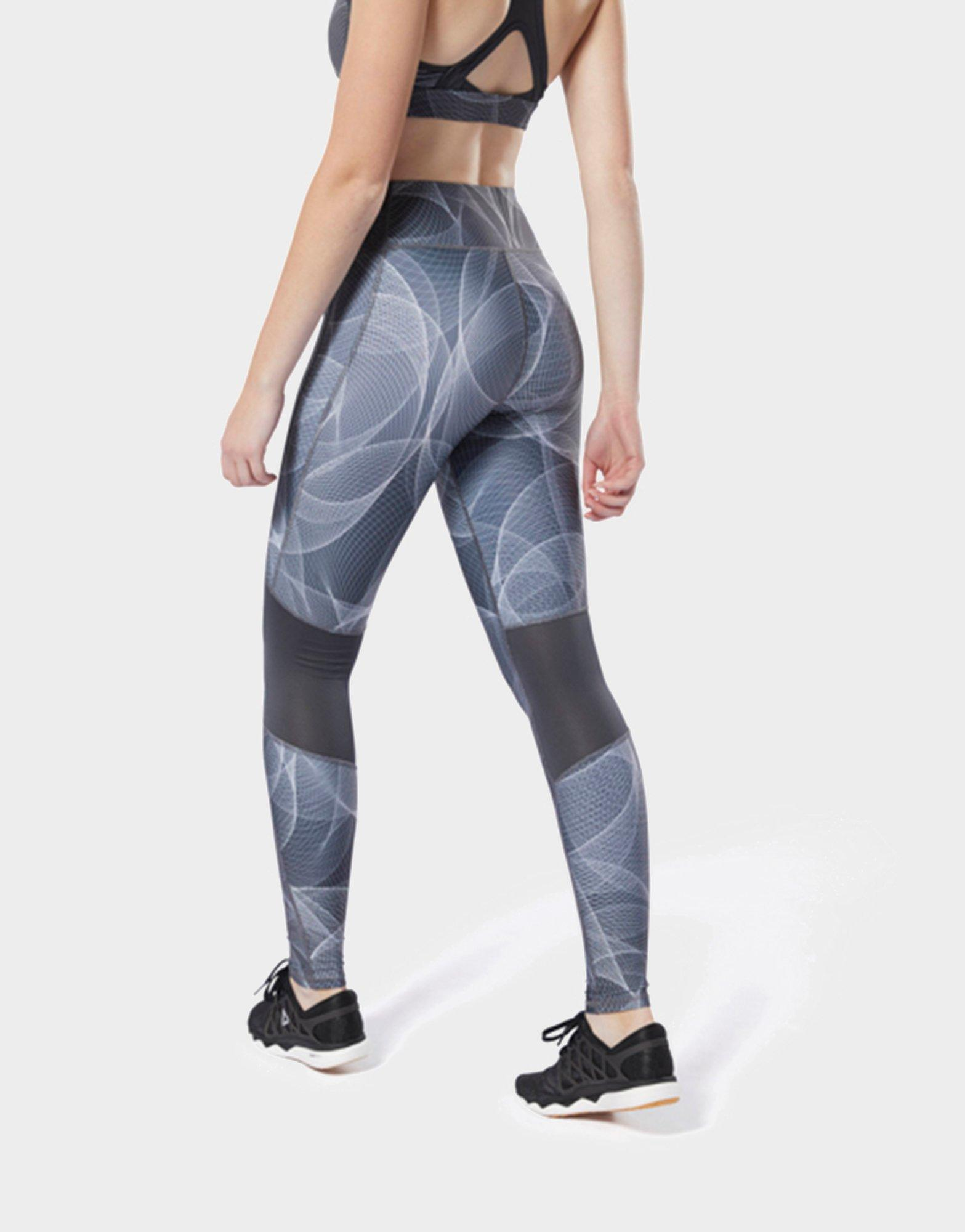 db487b436bc Lyst - Reebok Abstract Print Cropped Running Tights in Gray