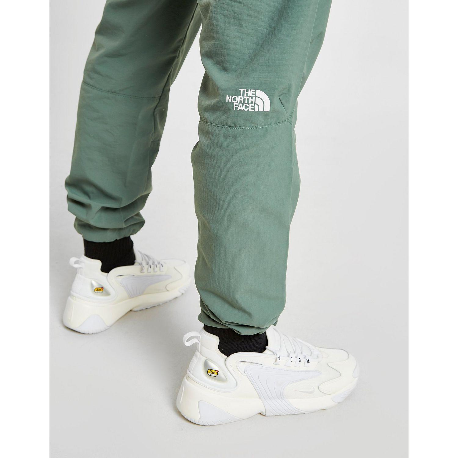 57edc1611f The North Face Zip Pocket Track Pants in Green for Men - Lyst