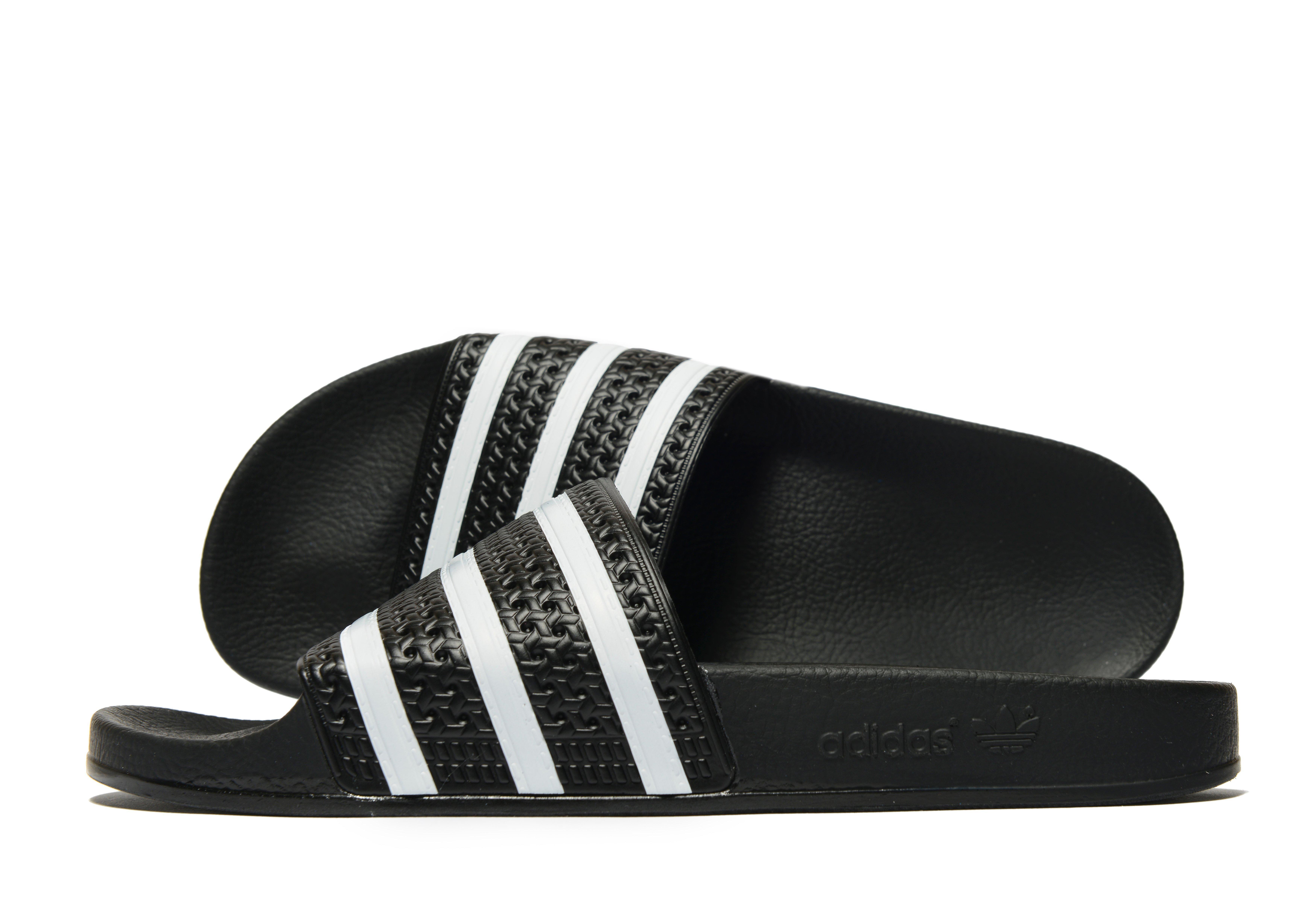 a002f88af8d609 Adidas Originals Adilette Slides in Black for Men - Lyst