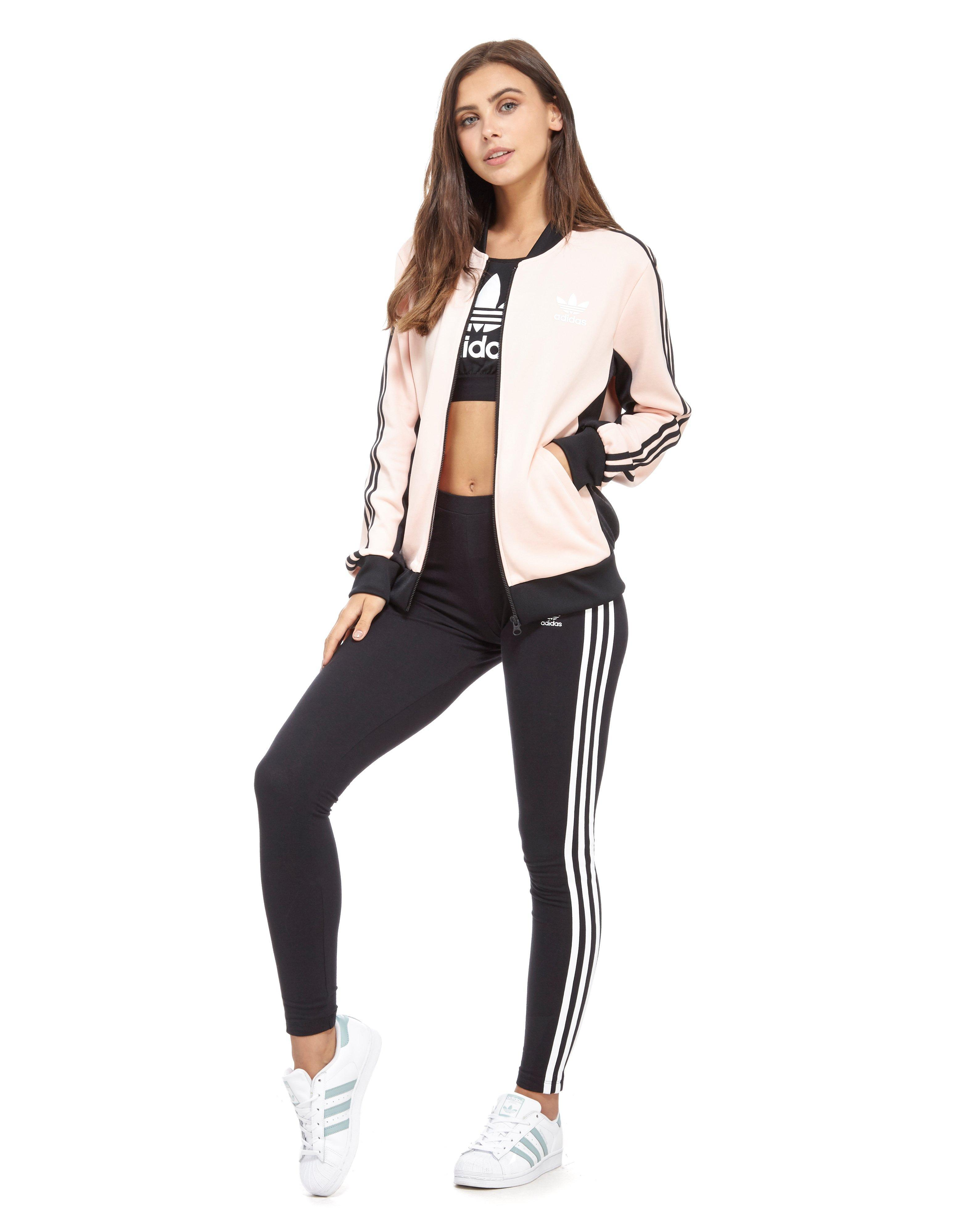 664c77caea Lyst - adidas Originals Supergirl Track Top in Pink