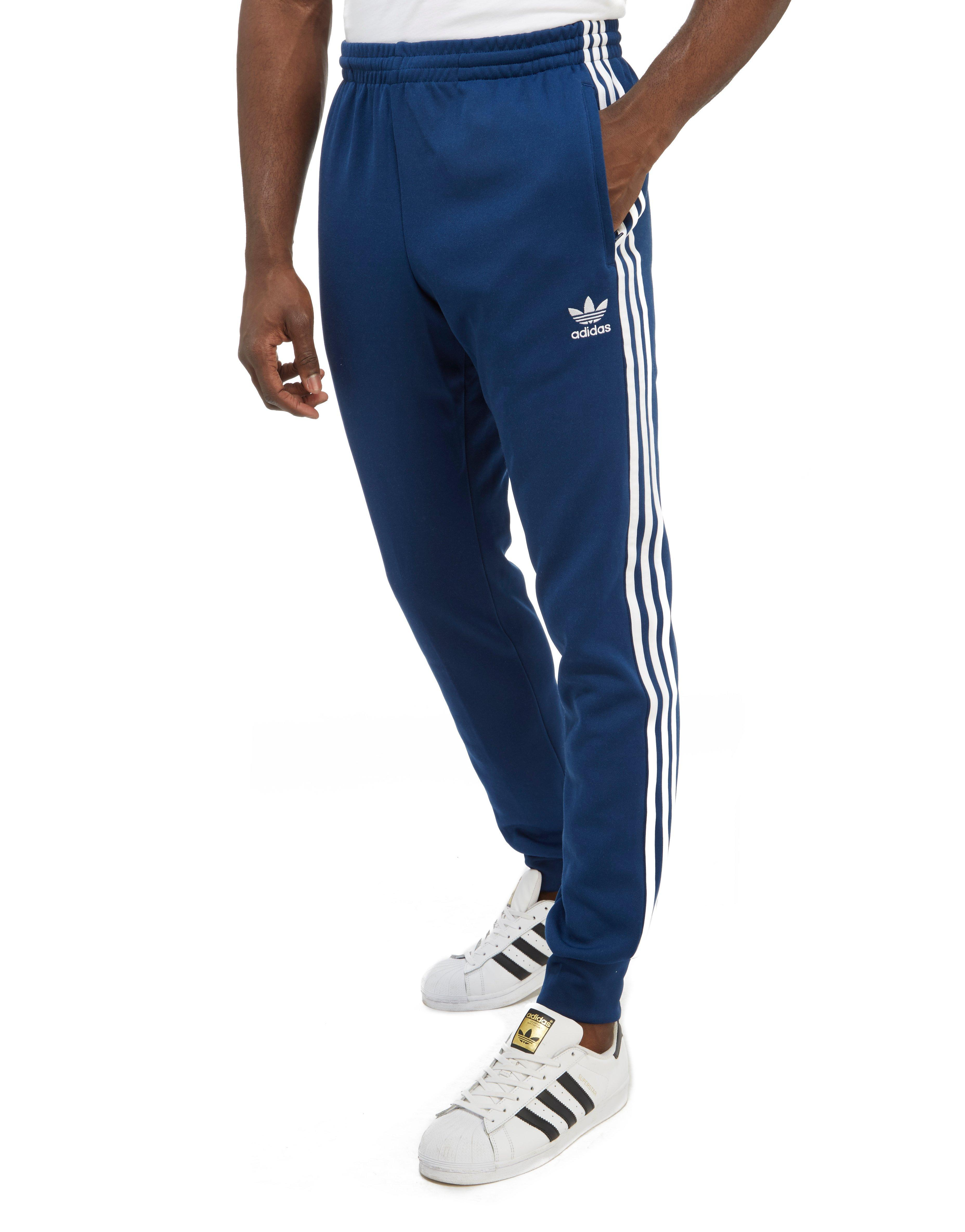 finest selection 94ae6 db567 adidas Originals 3-stripes Superstar Track Pants in Blue for Men - Lyst