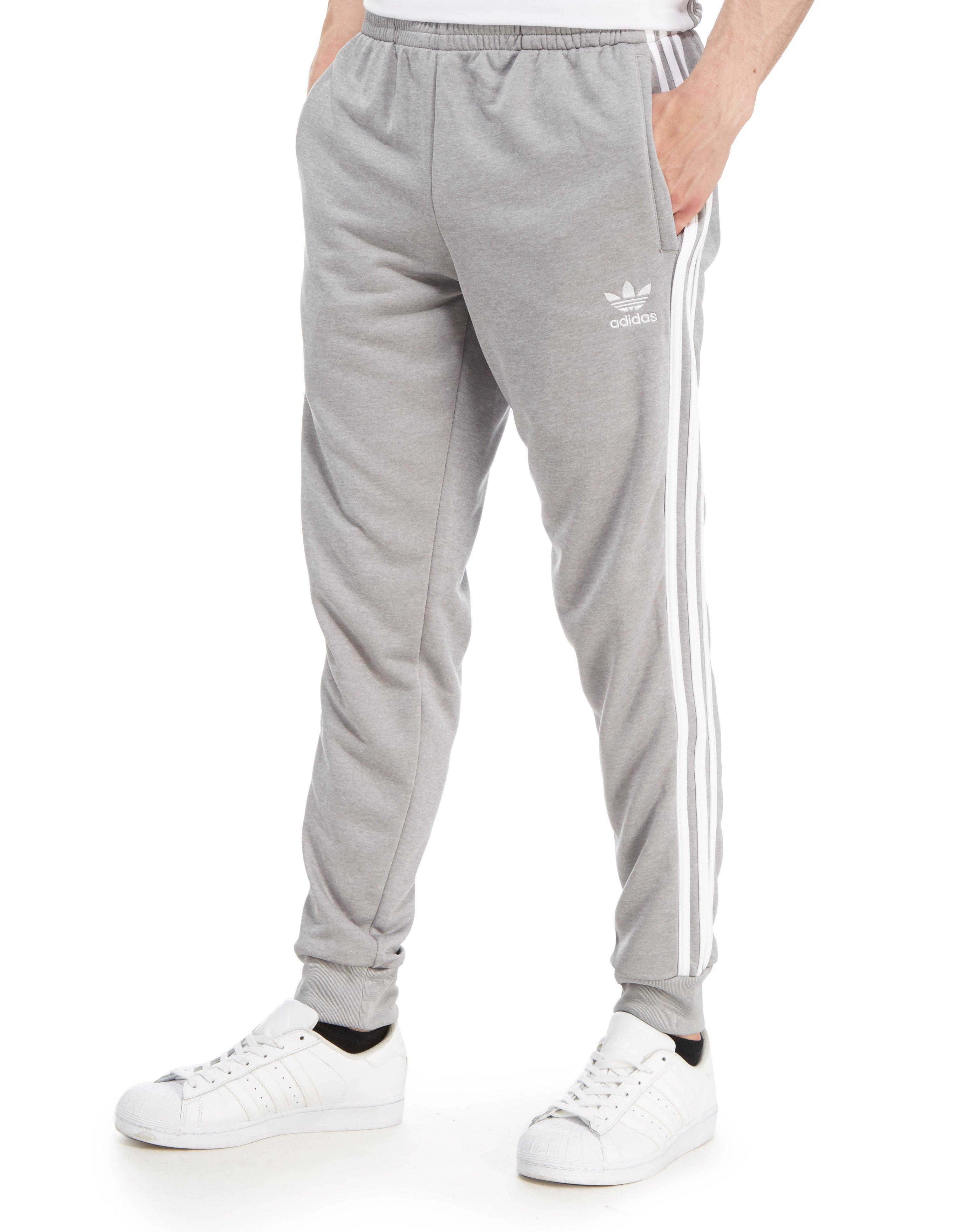 lyst adidas originals superstar poly track pants in gray