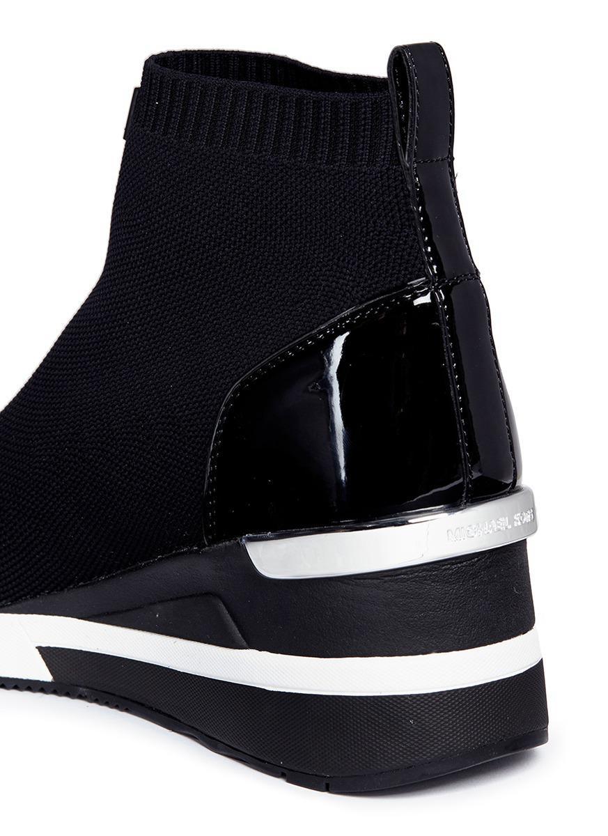ba06570fbe55 Lyst - Michael Kors  skyler  Knit Sock Sneaker Boots in Black