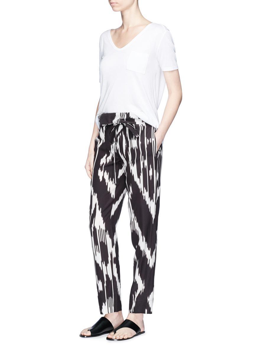 4f4952c3d27 Theory 'gunilla' Ikat Print Paperbag Waist Belted Silk Pants - Lyst