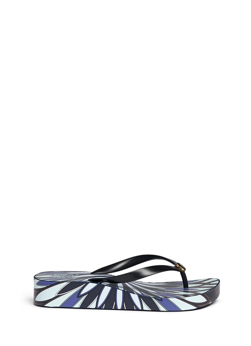 5990585fd Lyst - Tory Burch  thandie  Floral Print Wedge Flip Flops in Blue