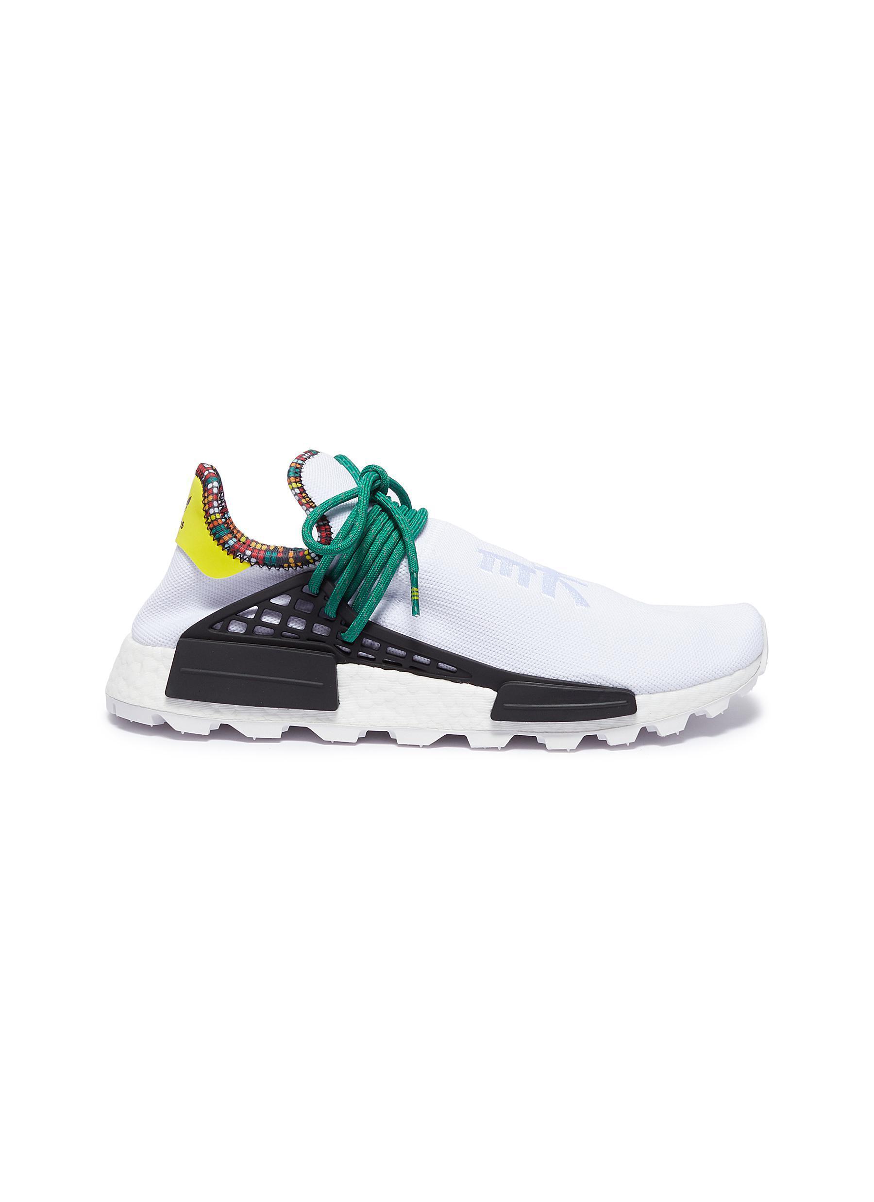 483f787f4be69 adidas Originals. Men s White  solarhu Nmd  Slogan Embroidered Primeknit  Sneakers