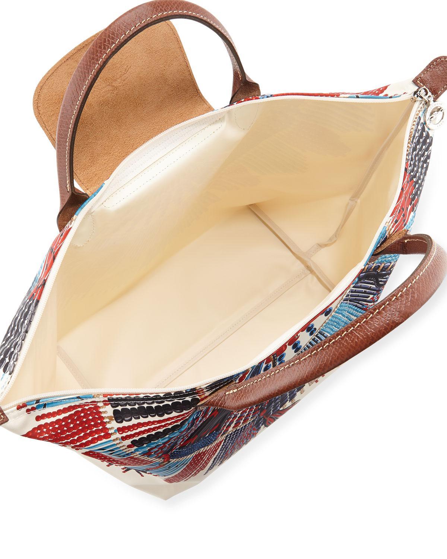 13243203c8b6 Lyst - Longchamp Le Pliage Collier Massai Medium Top Handle Bag - Save 20%