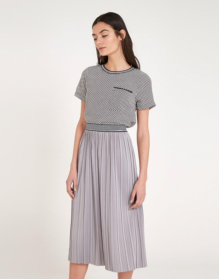 louche pleated midi skirt in gray lyst
