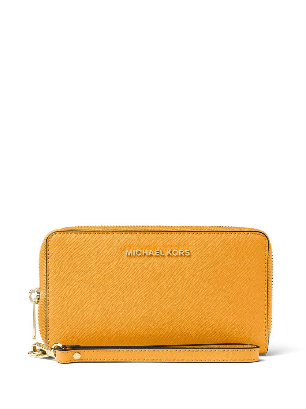 b6e6d1679547 Lyst - Michael Michael Kors Saffiano Leather Zip Wallet in Orange