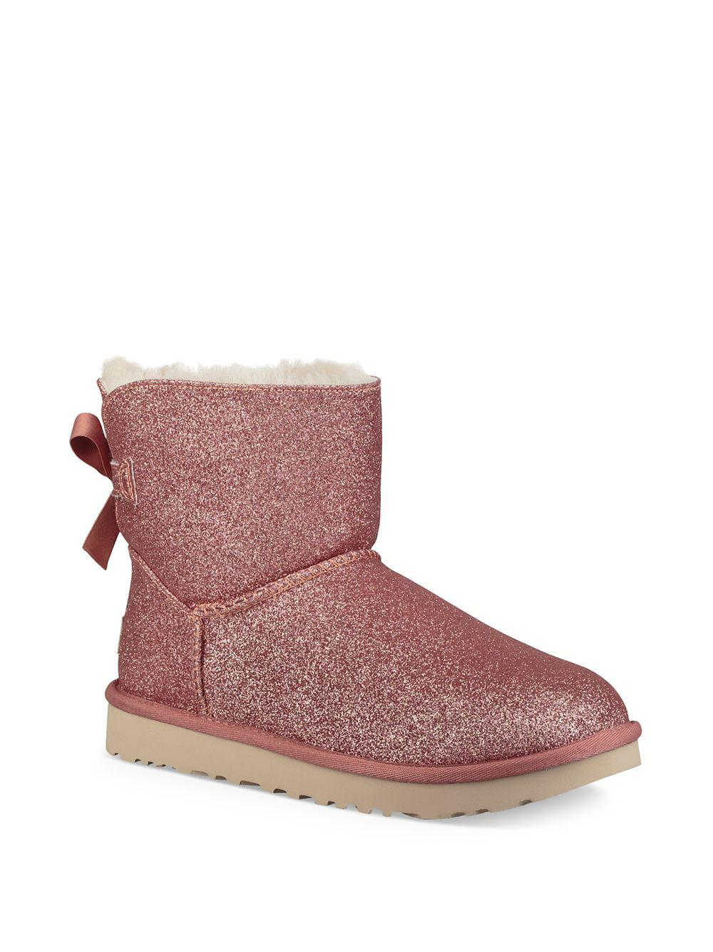 5ec40760d3a Ugg Mini Bailey Bow Sparkle Shearling Boots in Pink - Lyst