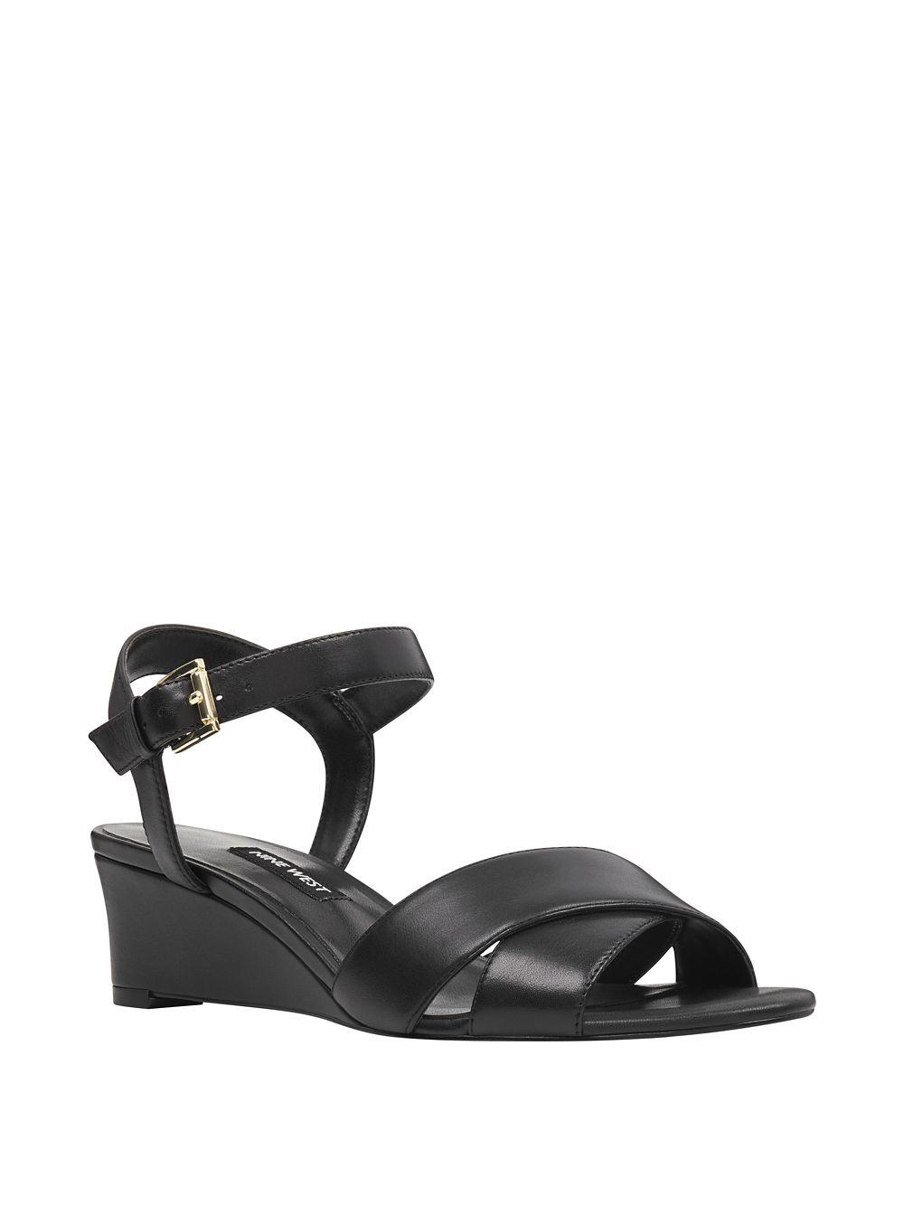 3a7dd6ab58d Lyst - Nine West Laglade Leather Wedge Sandals in Black