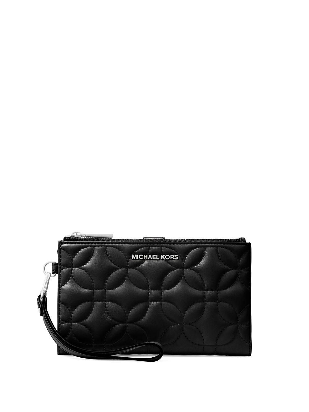 e2001088bed73 Lyst - Michael Michael Kors Quilted Double Zip Wristlet in Black
