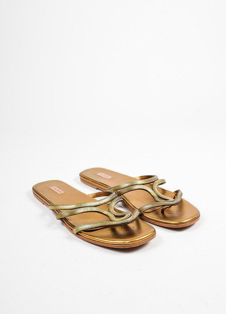 8e62f5d298e93 Lyst - Alaïa Gold Metallic Strappy Cut Out Flat Thong Slide Sandals ...