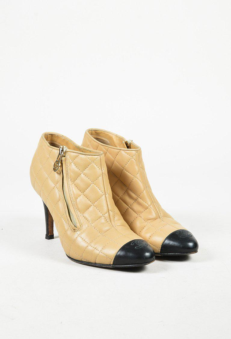 fea2f3ff8212 Lyst - Chanel Beige   Black Lambskin Quilted Cap Toe Ankle Booties ...