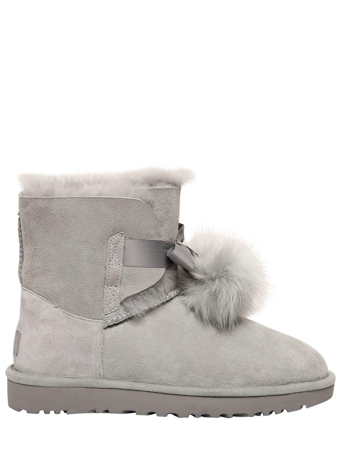 778fcabeaa4 UGG Gita Shearling Boots W/ Pompoms in Gray - Lyst