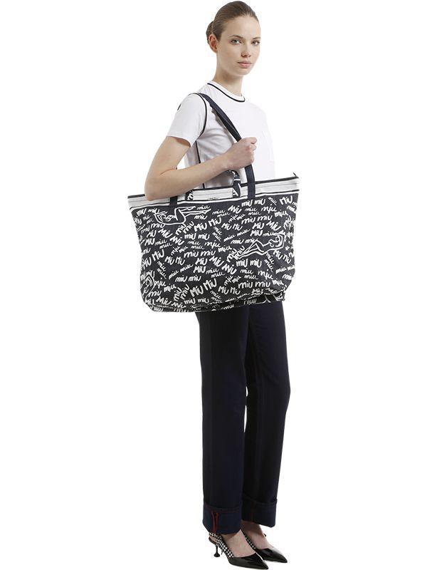 a110918f7bb1 Lyst - Miu Miu Printed Denim Tote Bag in Blue