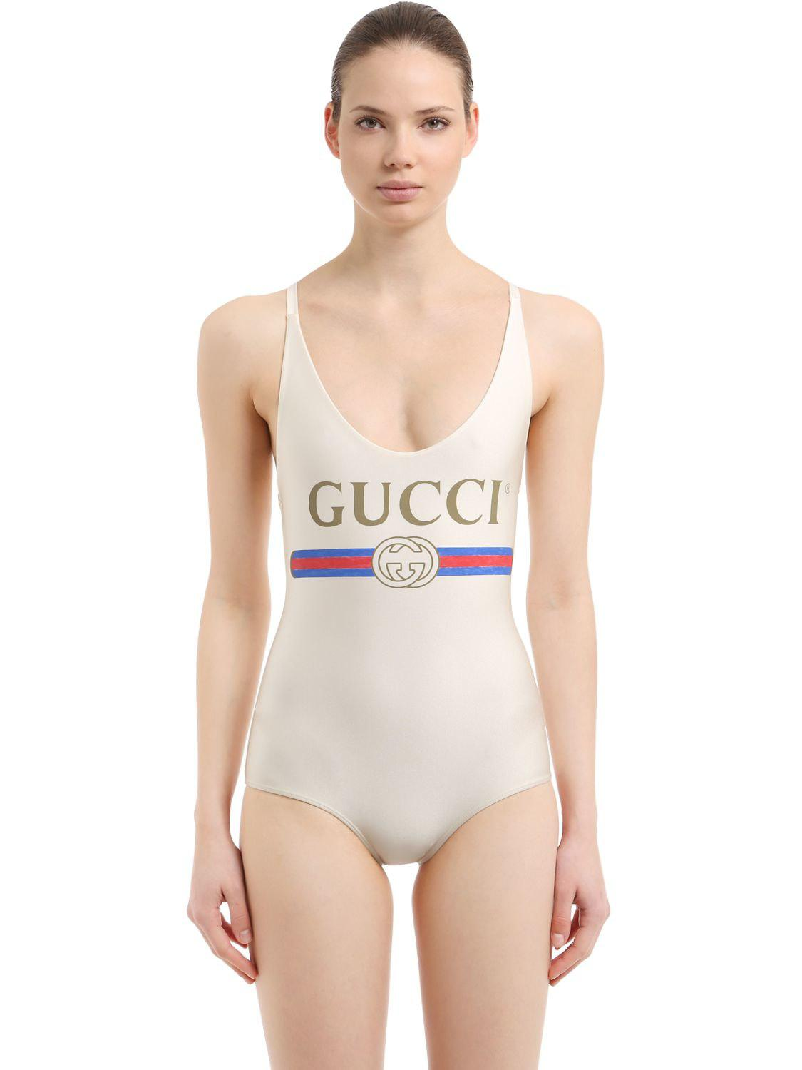 c2ed8a92f1c1e Gucci Logo Printed Lycra Swimsuit in White - Lyst