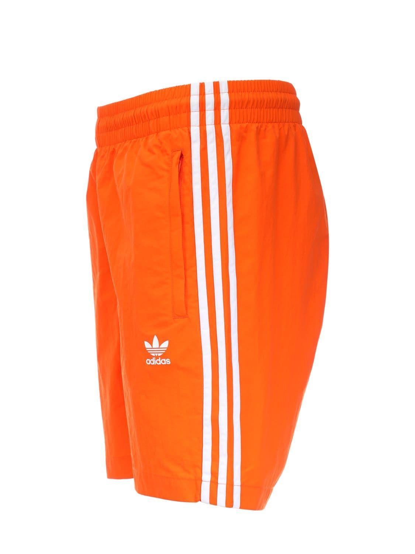 e86f43df2b Adidas Originals - Orange 3-stripes Swim Shorts for Men - Lyst. View  fullscreen