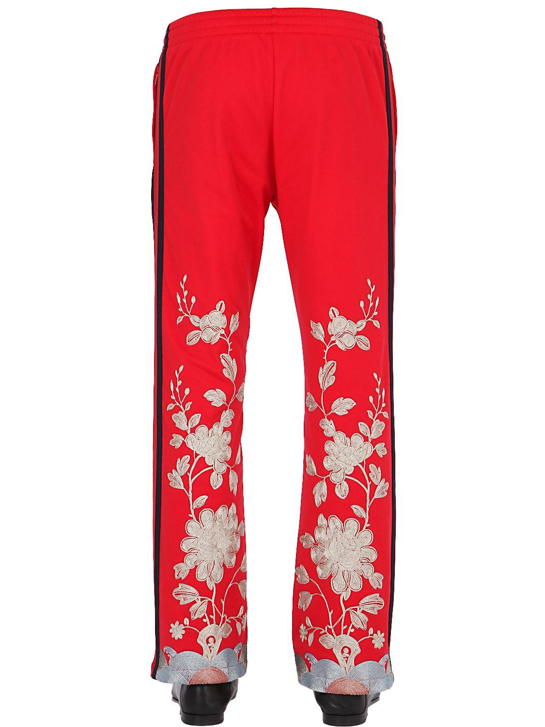 812ab62e2482ae Gucci Floral Embroidered Techno Jersey Pants in Red for Men - Lyst