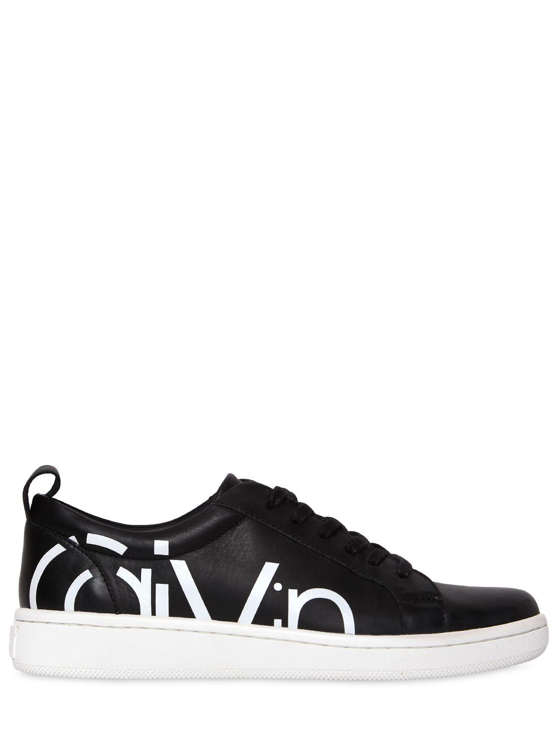 calvin klein jeans 20mm danya leather sneakers in black. Black Bedroom Furniture Sets. Home Design Ideas