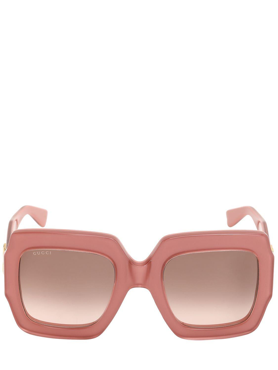 31a5dc660ed60 Lyst - Gucci Gg Logo Glossy Acetate Sunglasses in Pink