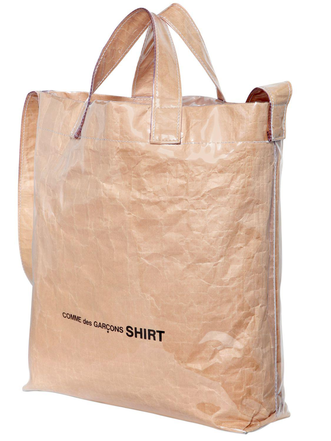 e215d7489 Comme des Garçons Logo Plastic Covered Paper Tote Bag in Natural - Lyst