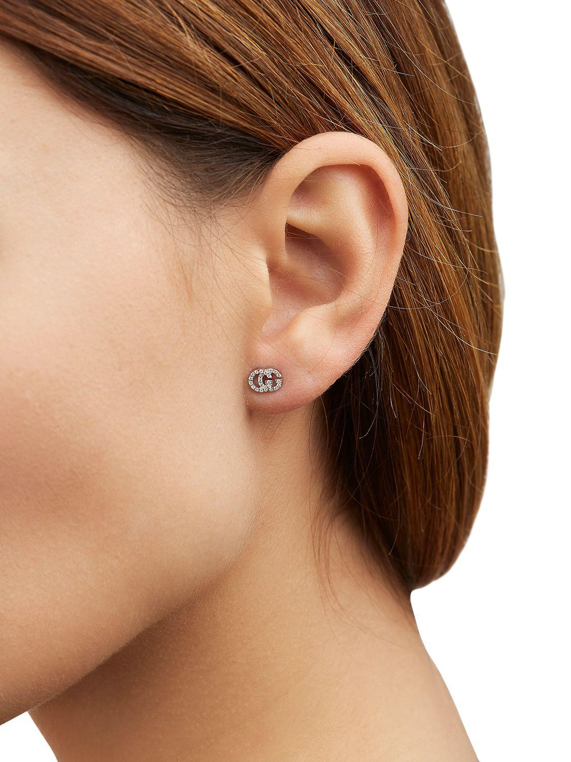 5f9f0d831a2414 Gucci Running G Diamond Stud Earrings in White - Lyst