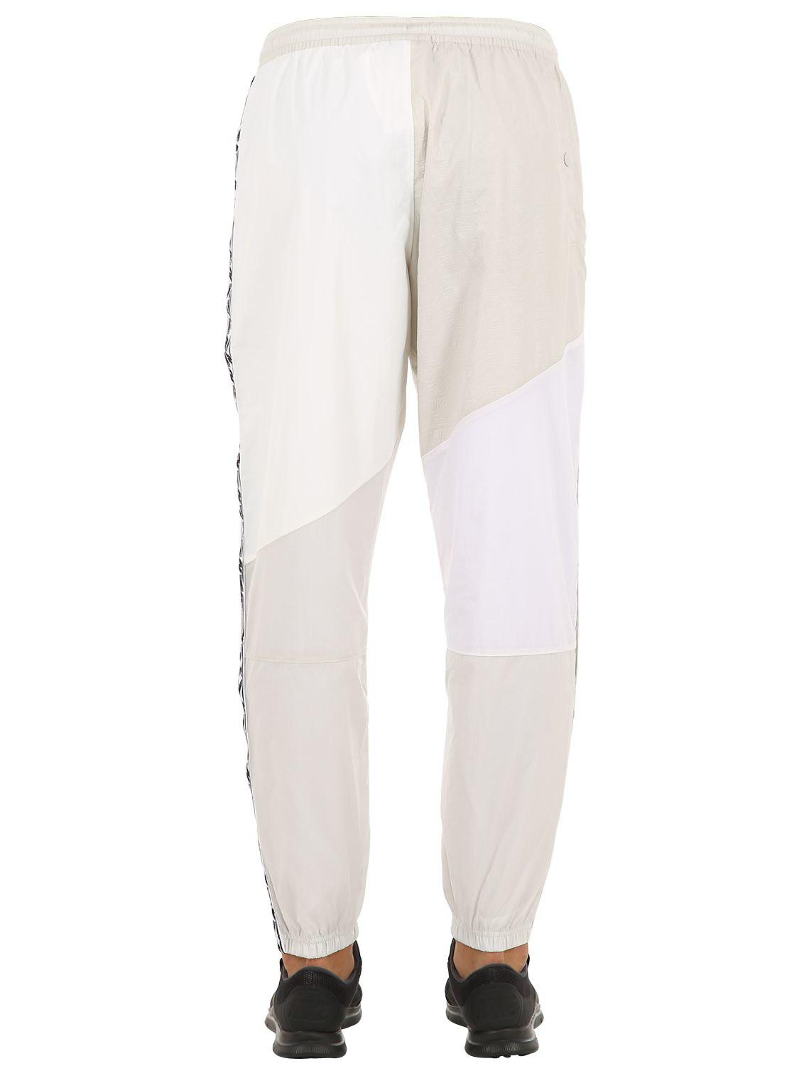 4c6cb3dff532 Lyst - Nike Nsw Taped Woven Track Pants in White for Men