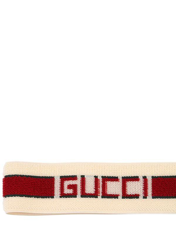 b9eef14750a Lyst - Gucci Logo Printed Sponge Headband in White