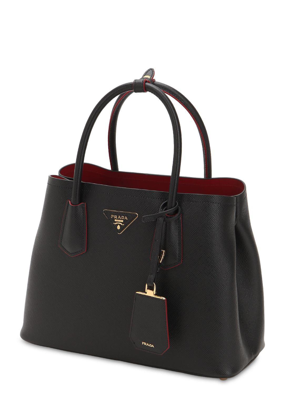... clearance prada black saffiano leather top handle bag lyst. view  fullscreen 965b8 ec2ed ... b09a330278445