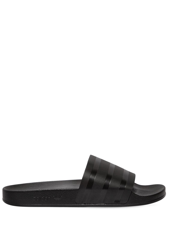 lyst adidas originali adilette cuoio slide sandali in nero per gli uomini.
