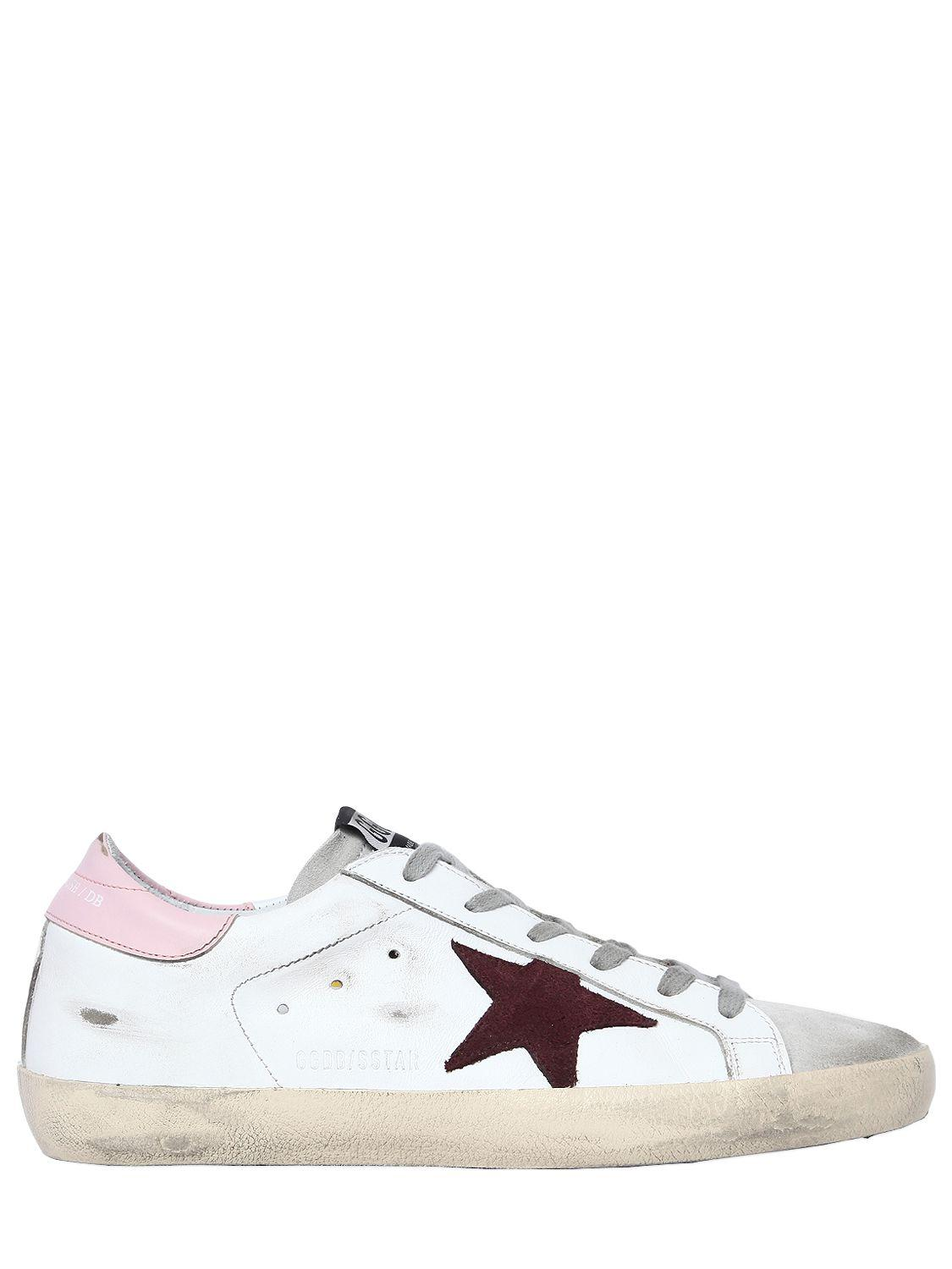 528cb8081ade Golden Goose Deluxe Brand. Women s White 20mm Super Star Leather Sneakers