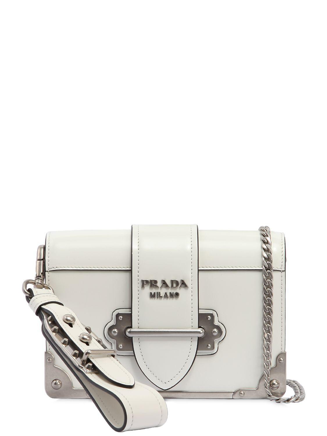 784721ed367f Lyst - Prada Small Cahier Polished Leather Bag in White
