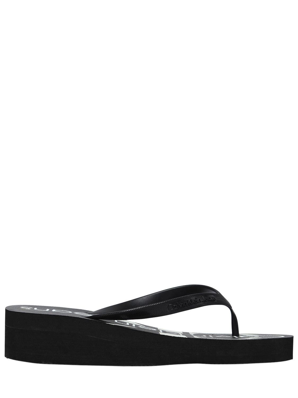 ac70ea8a49bf Calvin Klein 40mm Tesse Rubber Platform Flip Flops in Black - Lyst