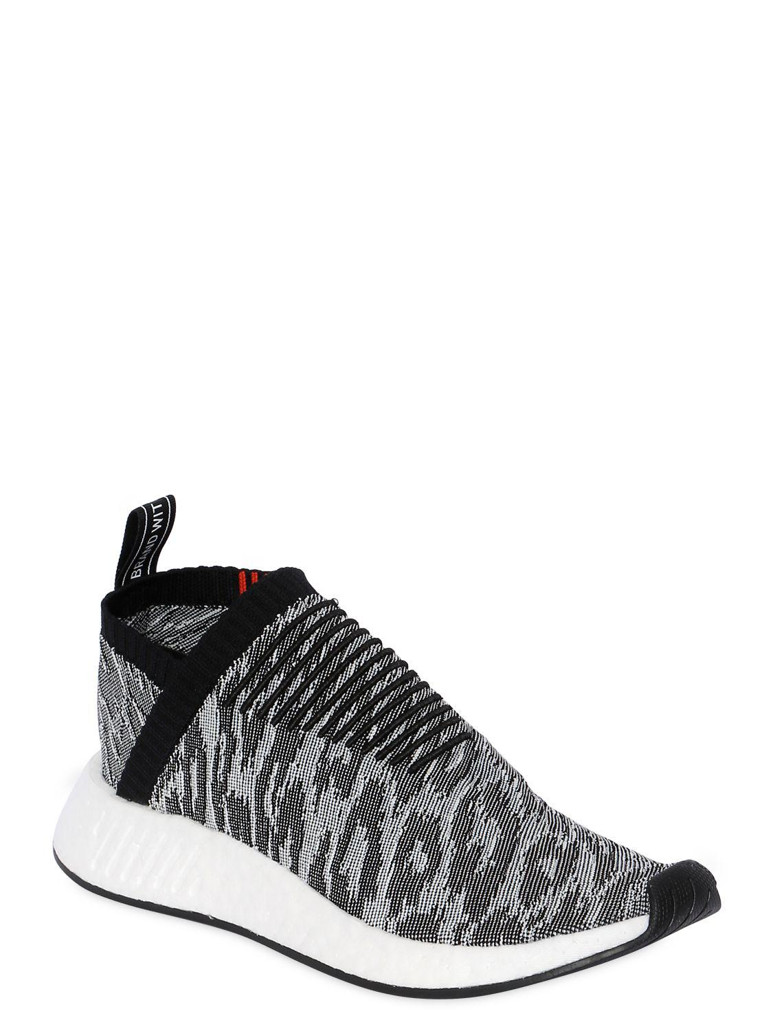 05a85ad4bbbd Lyst - adidas Originals Nmd Cs2 Leopard Primeknit Sneakers in Black ...