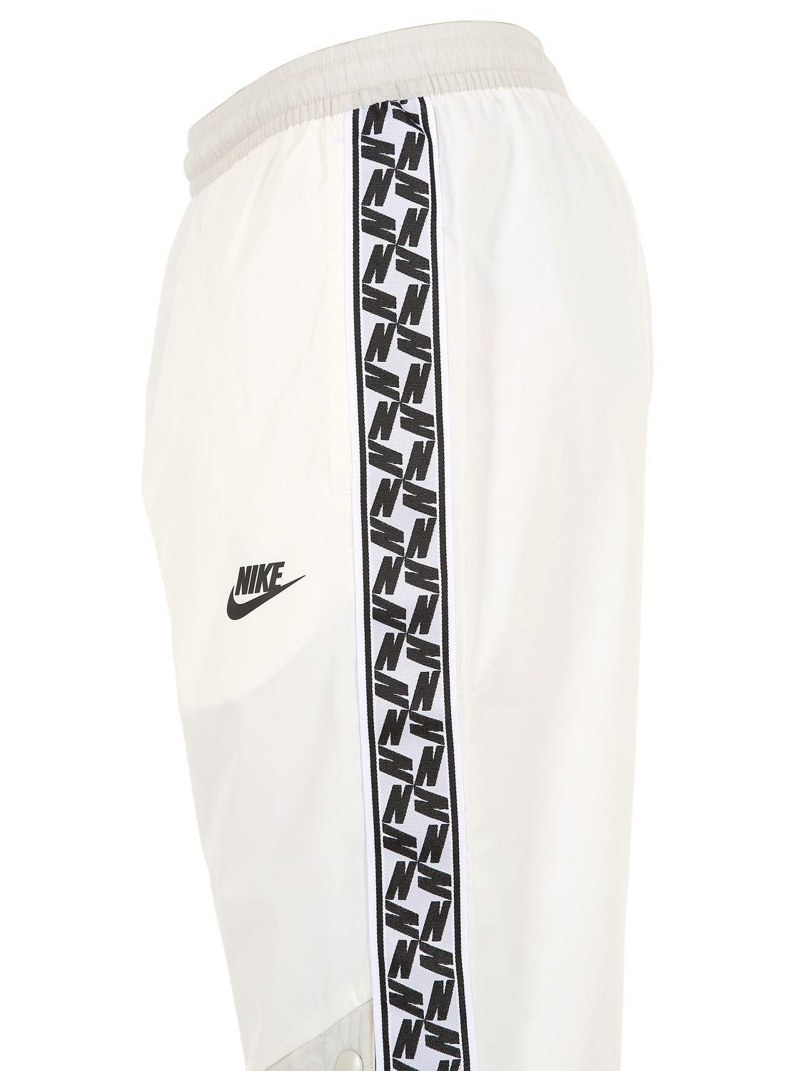 7727442d97cd Nike Nsw Taped Woven Track Pants in White for Men - Lyst