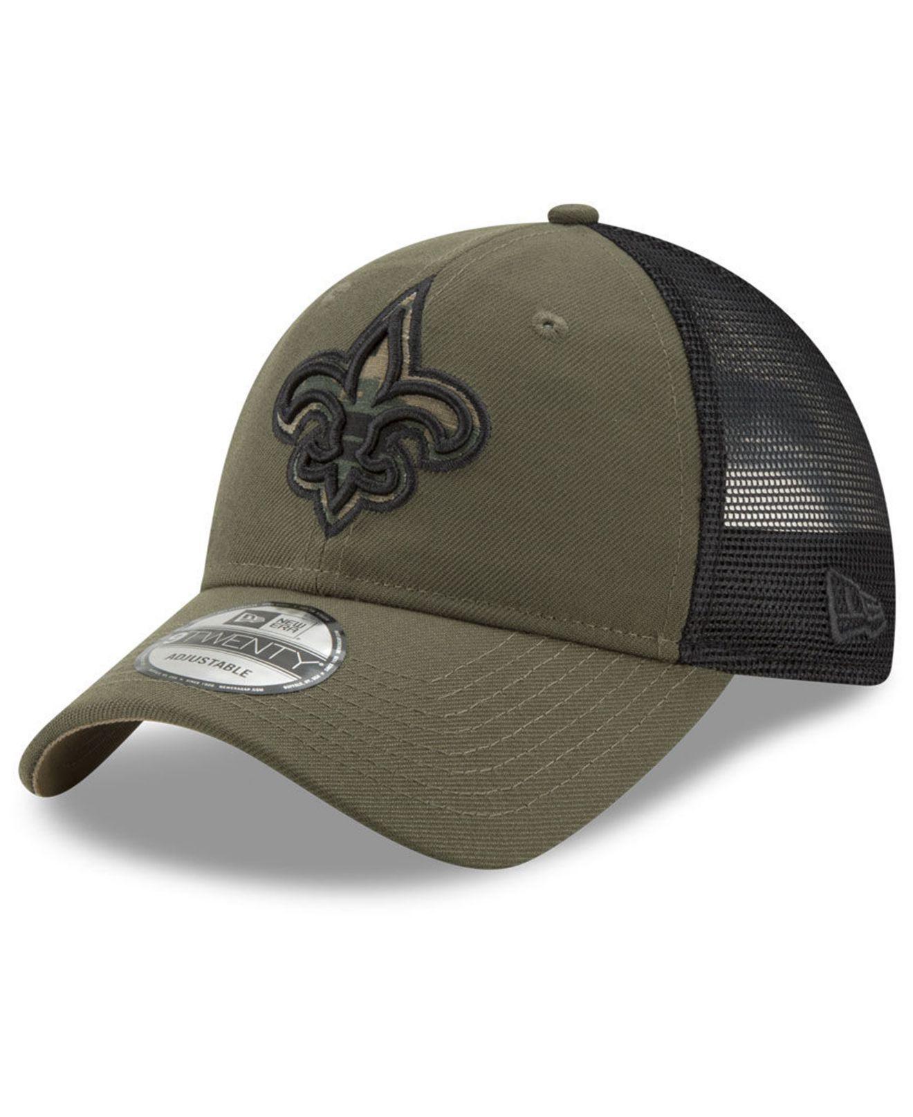 0386e46ac5d68 KTZ New Orleans Saints Camo Service Patch 9twenty Trucker Cap in ...