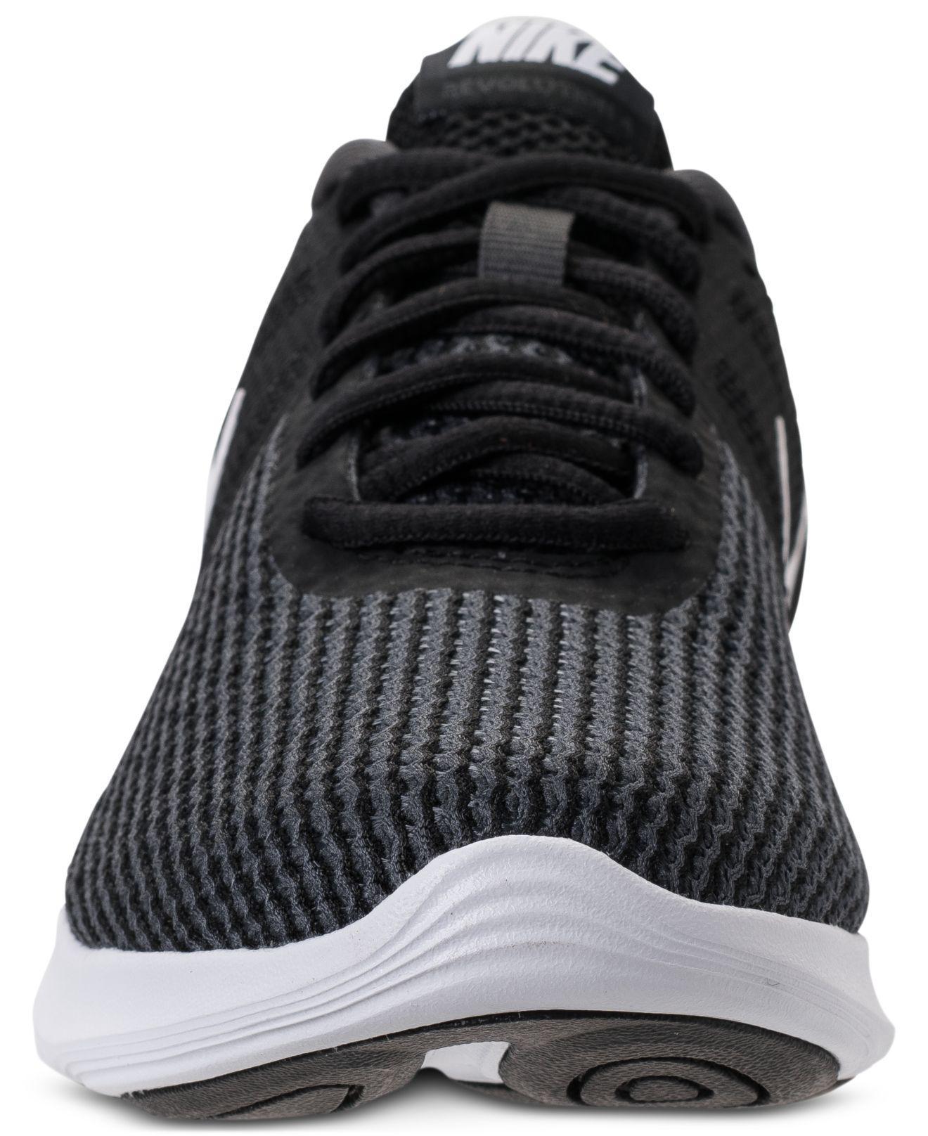 135fe6588dd20 Nike - Black Women s Revolution 4 Running Sneakers From Finish Line - Lyst.  View fullscreen