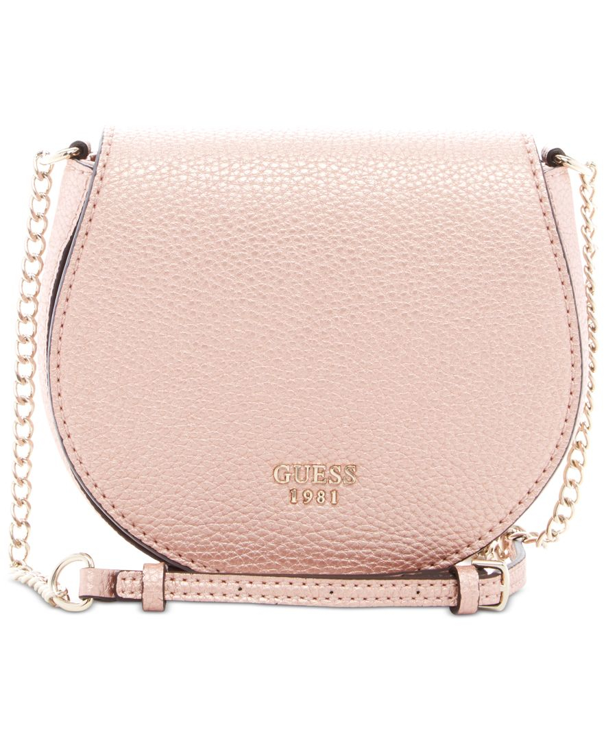 2657708c04 Lyst - Guess Cate Mini Saddle Crossbody Bag in Pink