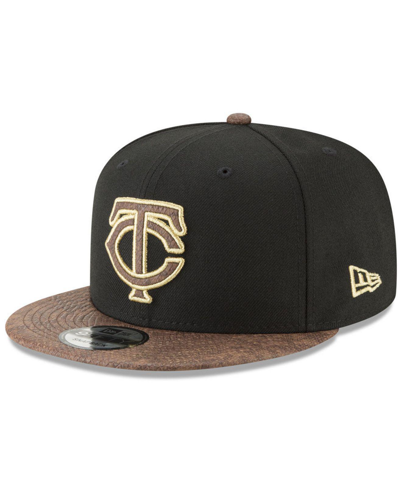 hot sales d63c6 a76df KTZ. Men s Black Minnesota Twins Gold Snake 9fifty Snapback Cap