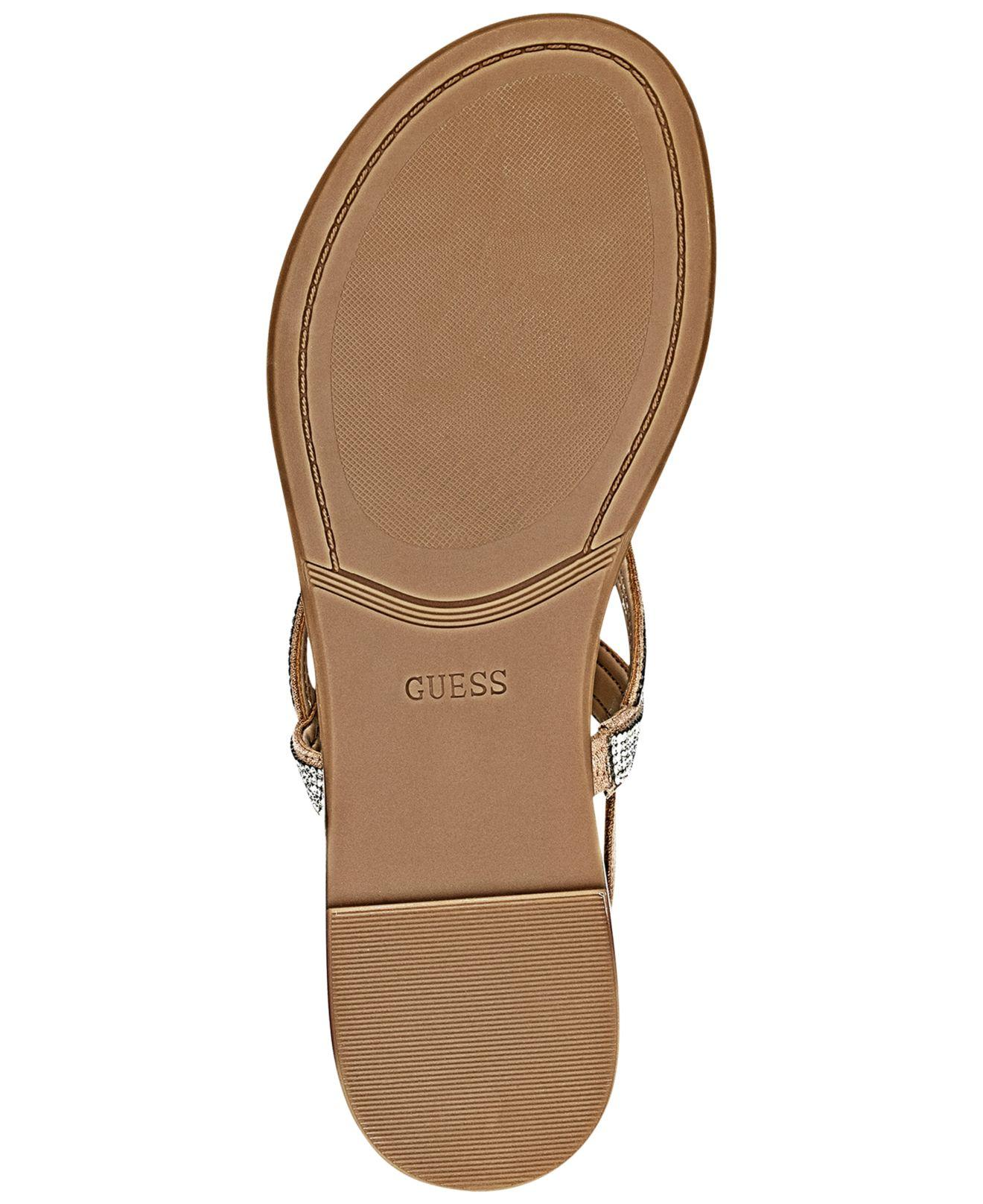 48215bab1 Lyst - Guess Women s Jabel Flat Sandals