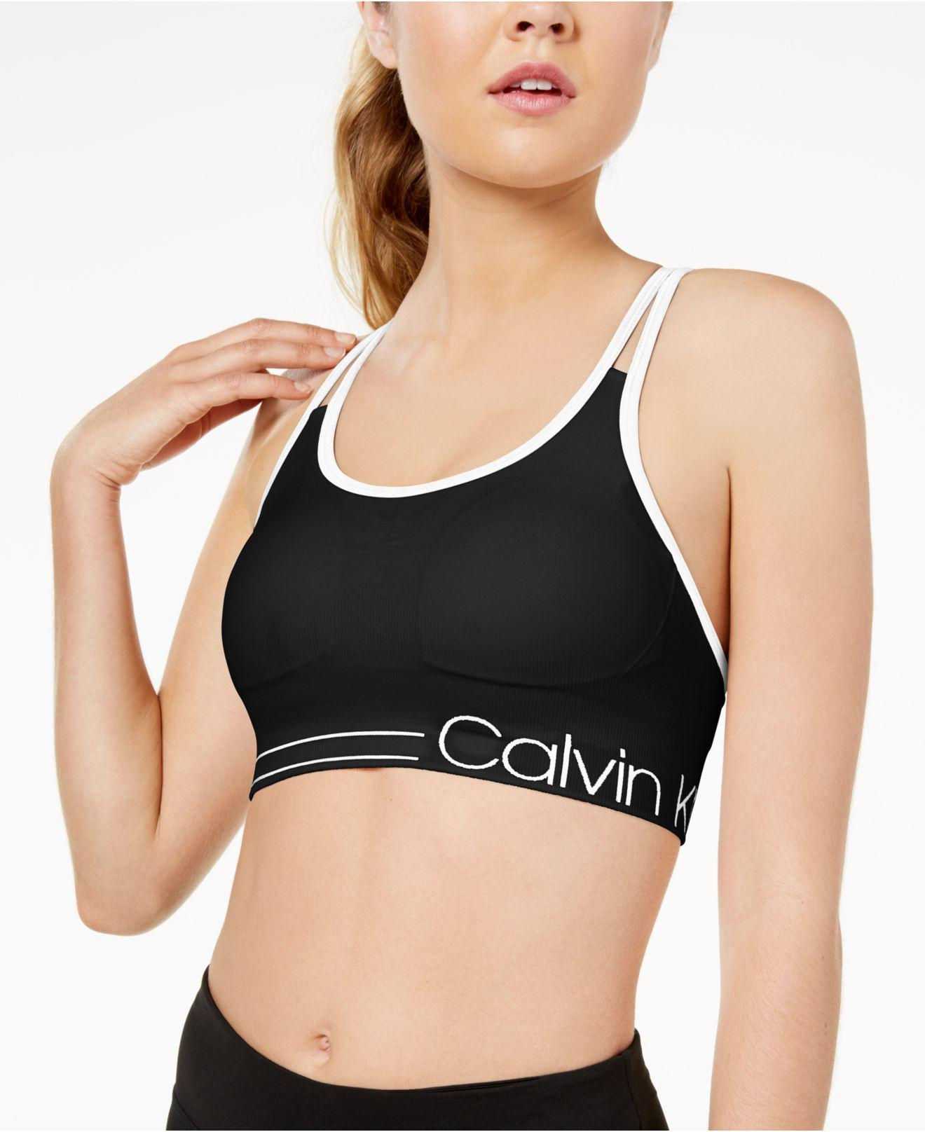 Calvin Klein. Women s Black Performance Strappy-back Low-impact Sports Bra  Pfyt2413 3b925fb46