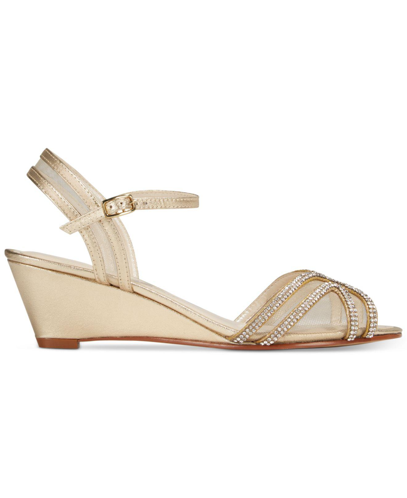 c31f2939d09 Lyst - Caparros Hilton Strappy Evening Wedge Sandals in Metallic