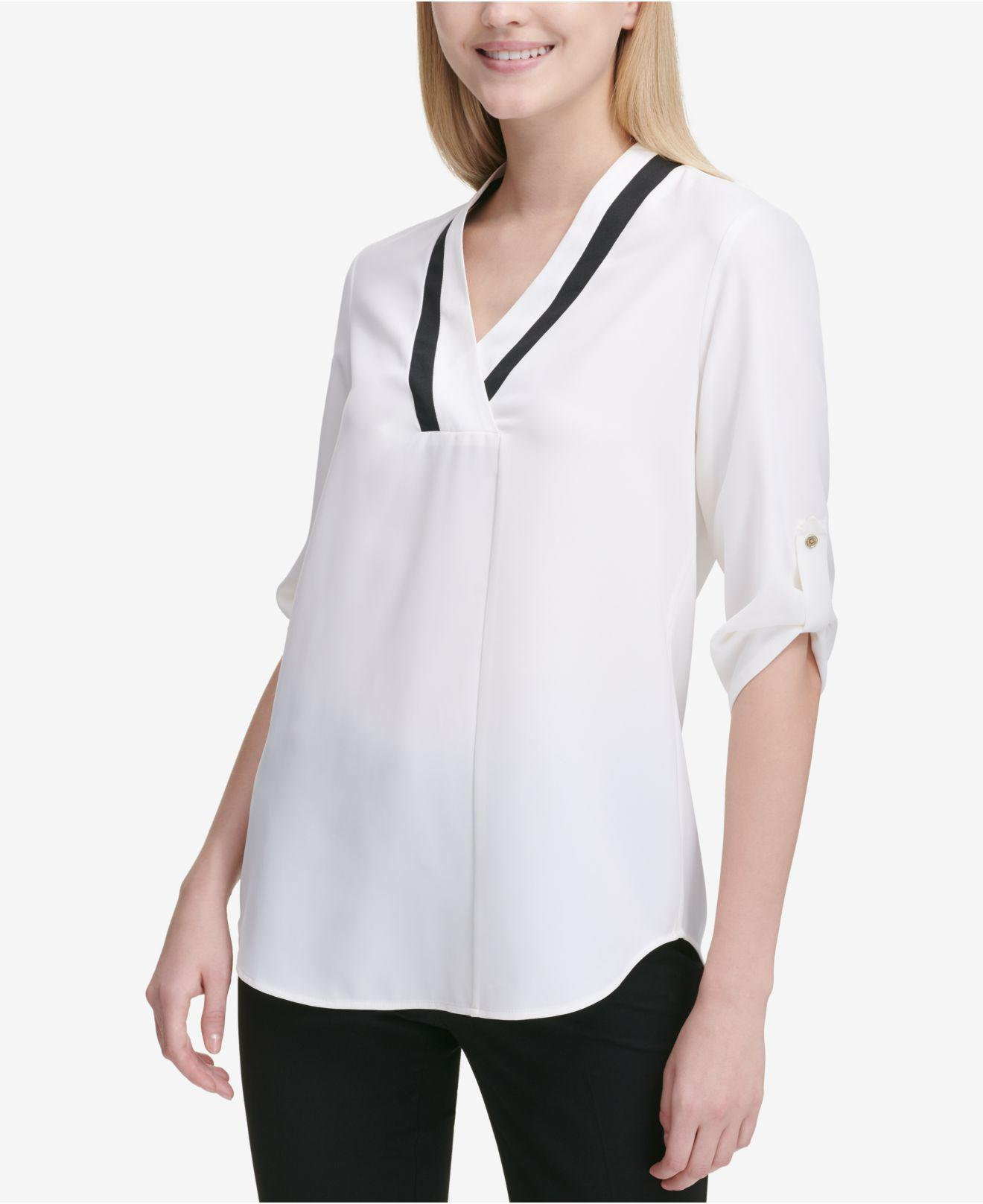 94100a7bd3b8 Lyst - Calvin Klein Contrast-neck Roll-tab-sleeve Top in White