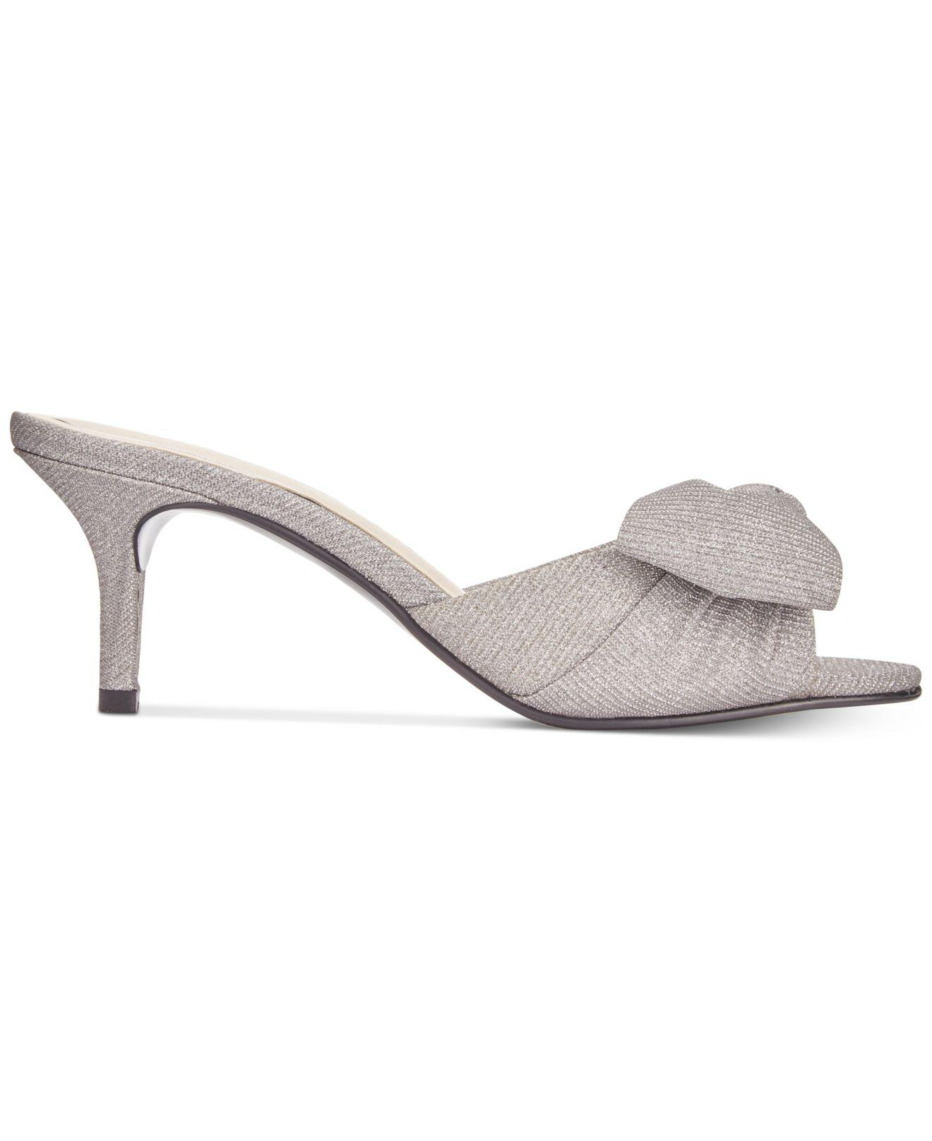 a8fefb46430 Lyst - Caparros Lydia Bow Slide Evening Sandals