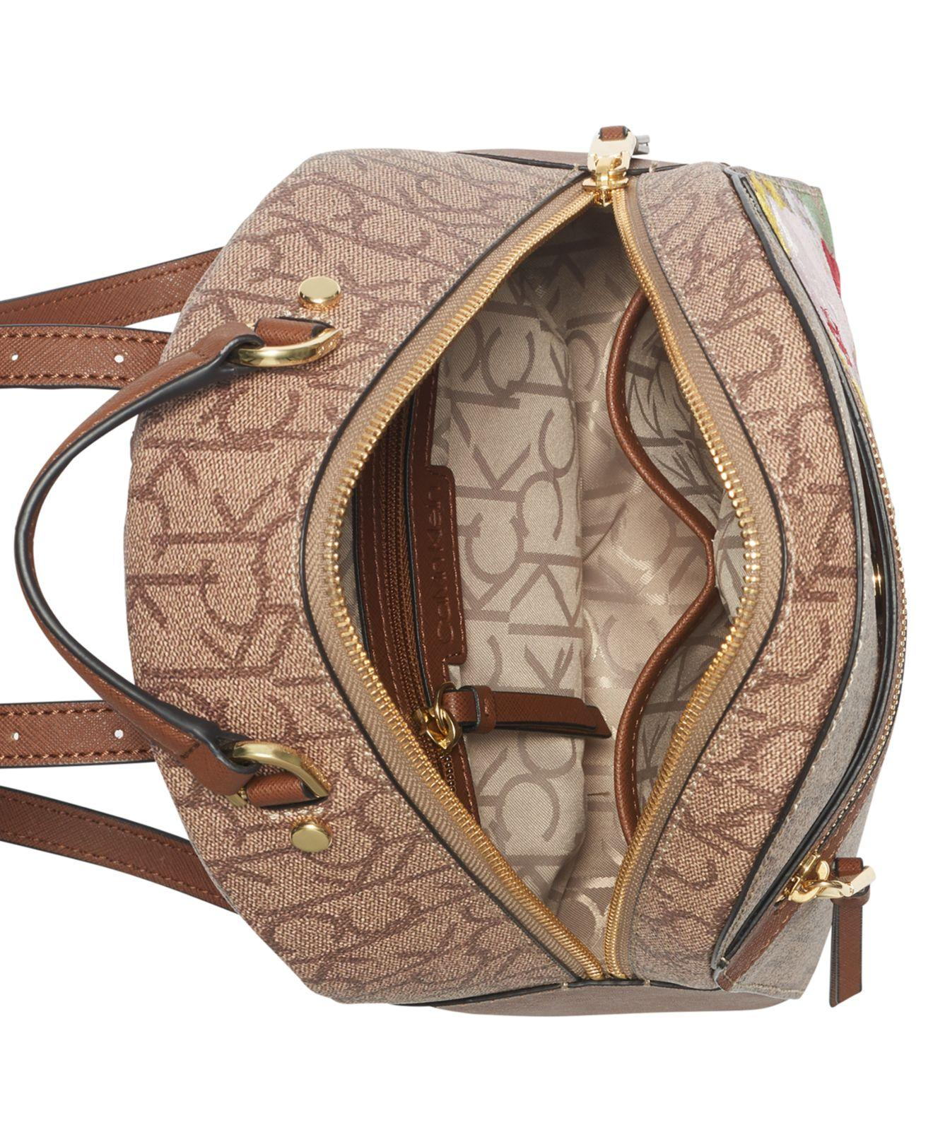 c837c98285 Lyst - Calvin Klein Mercy Signature Floral Backpack in Brown