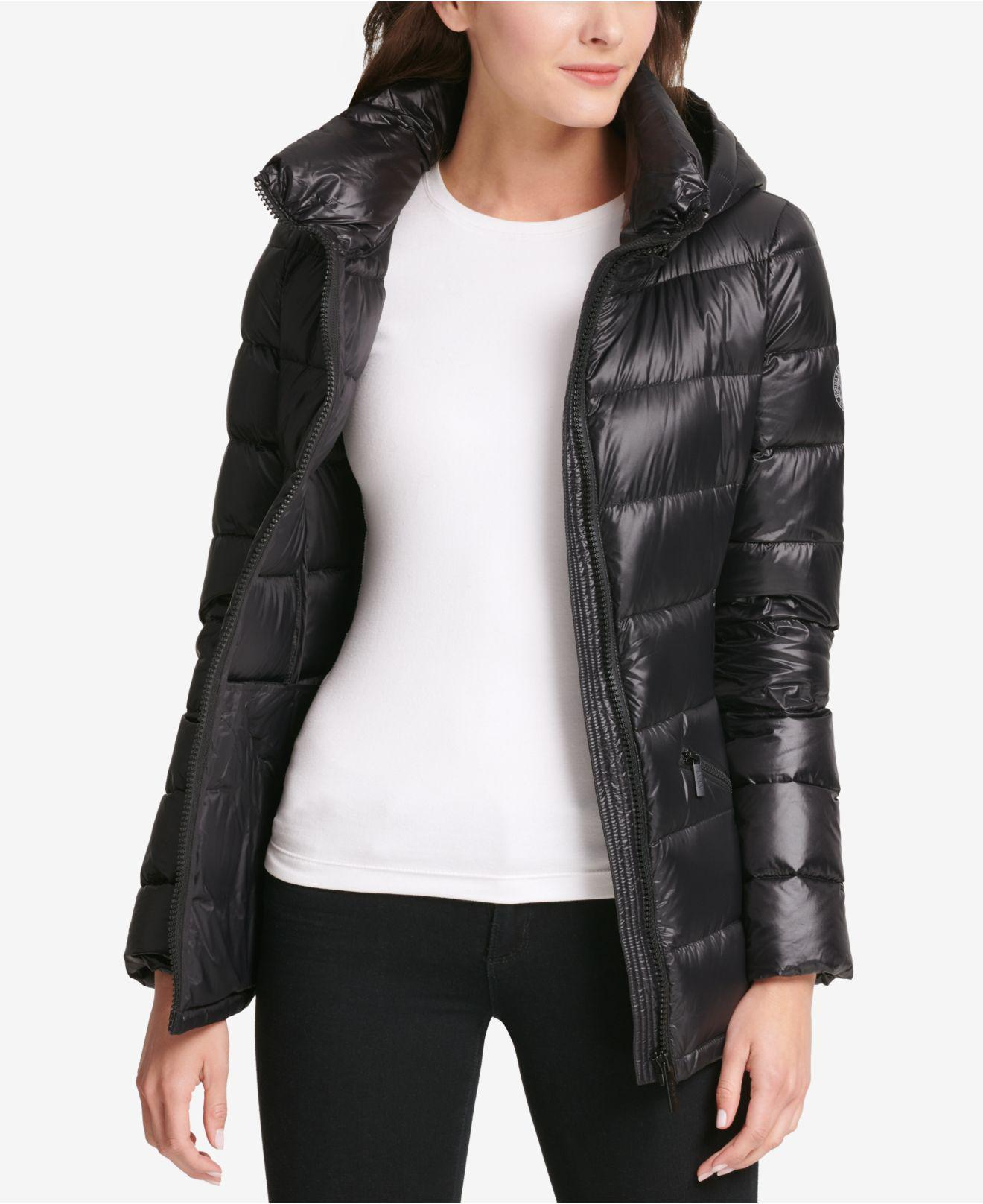 7030620b82987 Lyst - DKNY Logo-band Belted Puffer Coat in Black - Save 34%