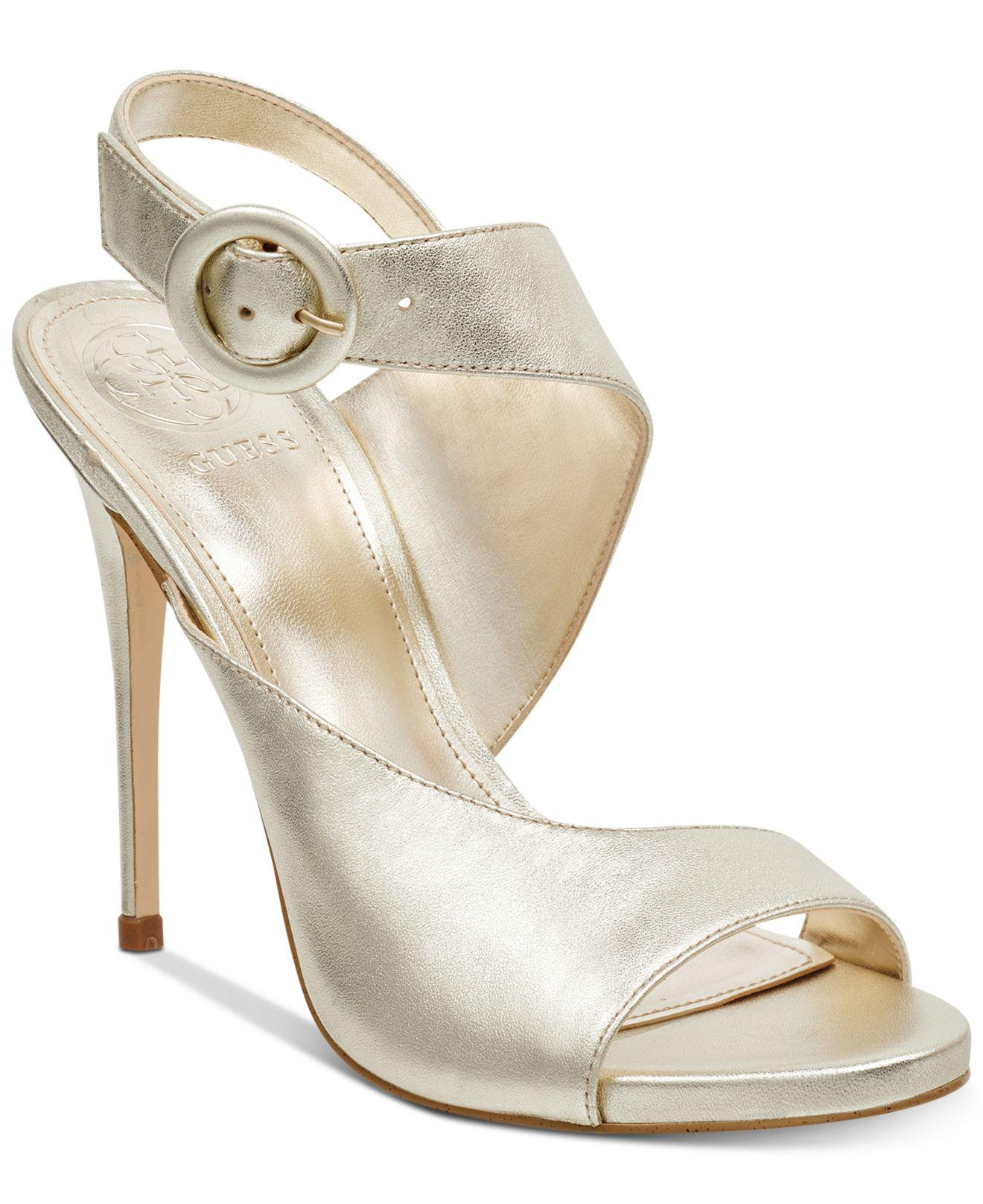 64abe8a3ed Guess Tyson Asymmetrical Sandals in Metallic - Lyst