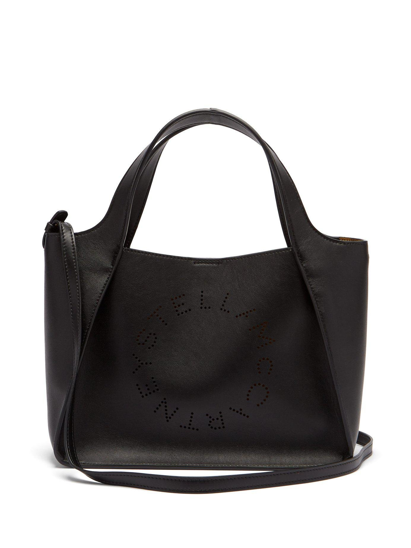 a11767253495 Stella McCartney. Women s Black Stella Perforated Logo Faux Leather Tote Bag